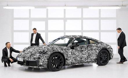 Интрига не раскрыта Porsche недопоказал спорткупе 911 нового поколения